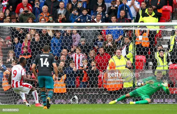 Fraser Forster of Southampton makes a save a penalty taken by Saido Berahino of Stoke City during the Premier League match between Stoke City and...