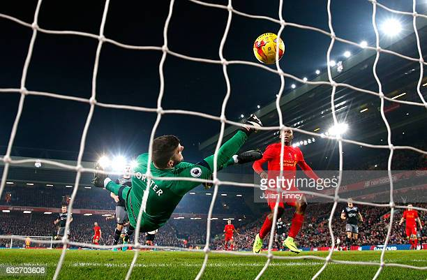Fraser Forster of Southampton makes a save during the EFL Cup SemiFinal Second Leg match between Liverpool and Southampton at Anfield on January 25...