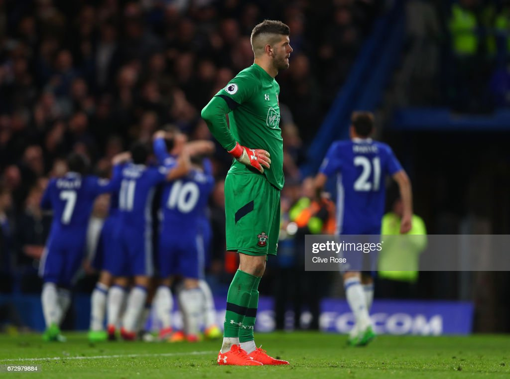 Fraser Forster of Southampton reacts as Diego Costa of Chelsea scores their fourth goal during the Premier League match between Chelsea and Southampton at Stamford Bridge on April 25, 2017 in London, England.