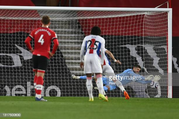 Fraser Forster of Southampton saves a penalty taken by Luka Milivojevic of Crystal Palace during the Premier League match between Southampton and...