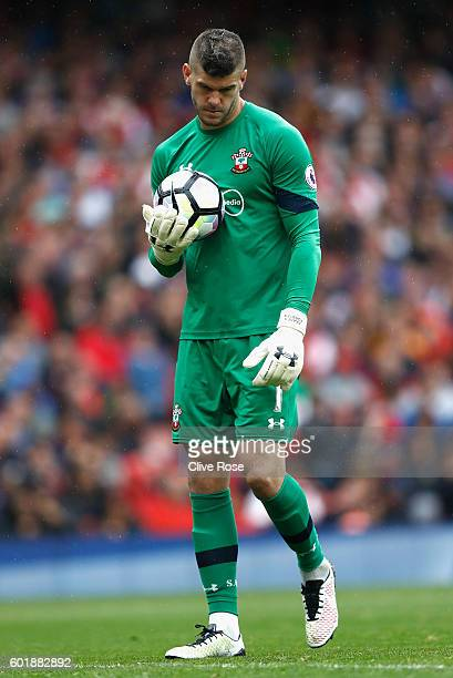 Fraser Forster of Southampton shows dejection during the Premier League match between Arsenal and Southampton at Emirates Stadium on September 10...