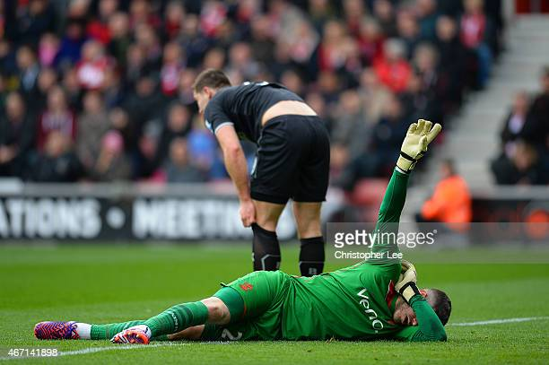 Fraser Forster of Southampton signals to the bench after picking up an injury during the Barclays Premier League match between Southampton and...