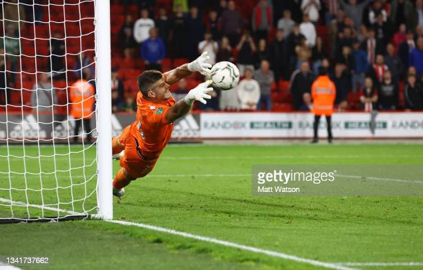 Fraser Forster of Southampton stretches for a penalty during the Carabao Cup Third Round match between Sheffield United and Southampton at Bramall...