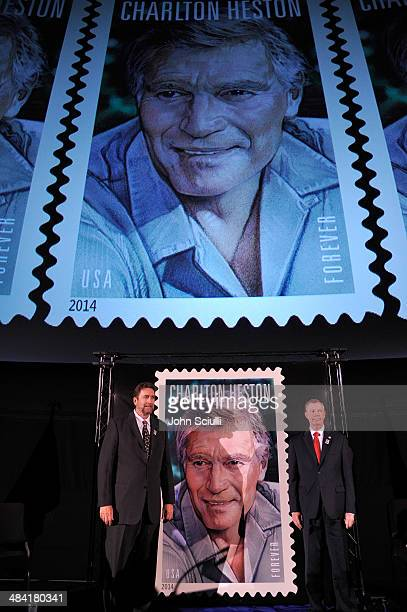 Fraser Heston and Mickey D Barnett onstage at the postage stamp ceremony during the 2014 TCM Classic Film Festival at TCL Chinese Theatre on April 11...