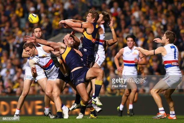 Fraser McInnes and Mark LeCras of the Eagles contest a mark against Fletcher Roberts and Matthew Boyd of the Bulldogs during the round eight AFL...