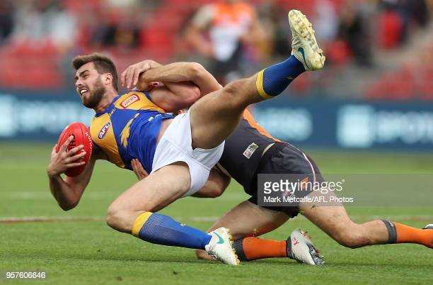 Fraser McInnes of the Eagles is tackled during the round eight AFL match between the Greater Western Giants and the West Coast Eagles at Spotless...