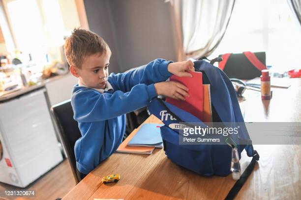 Fraser Mcintosh is seen getting ready for school on February 22, 2021 in Lossiemouth, Scotland. Scotland's youngest primary school pupils are...