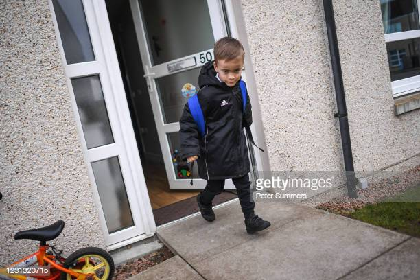 Fraser Mcintosh is seen leaving for school on February 22, 2021 in Lossiemouth, Scotland. Scotland's youngest primary school pupils are returning...