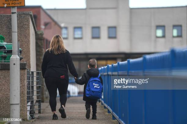 Fraser Mcintosh is seen walking to school on February 22, 2021 in Lossiemouth, Scotland. Scotland's youngest primary school pupils are returning...