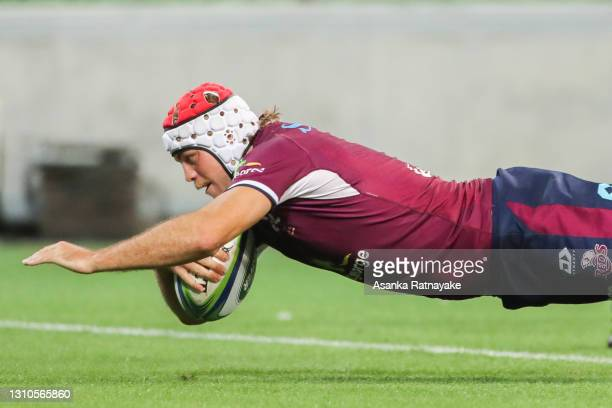 Fraser McReight of the Reds dives to score a try during the Super RugbyAU, round 7 match between the Melbourne Rebels and the Queensland Reds at AAMI...