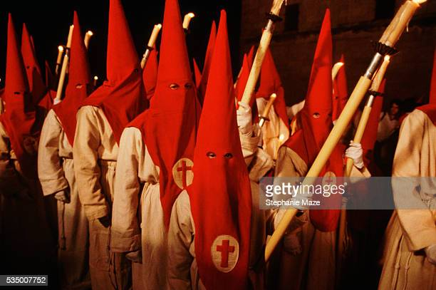 Fraternity Members Wearing Red Pointed Hoods