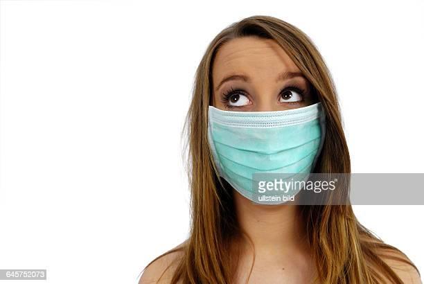 Frau mit Mundschutz, Schweinegrippe
