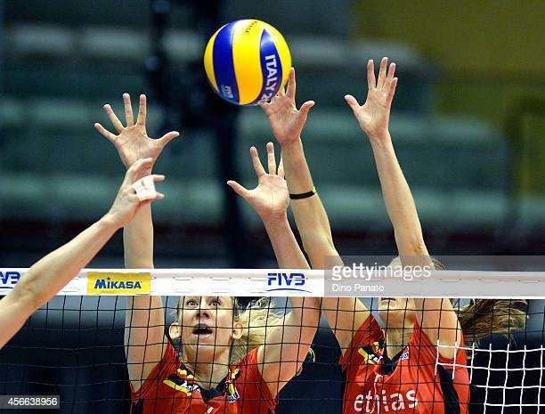 Frauke Dirickx and Angie Bland of Belgium tries to save a spike during the FIVB Women's World Championship pool E match between Germany and Belgium...