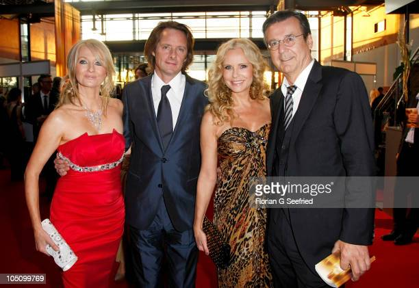 Frauke Ludowig and husband Kai Roeffen Katja Burkard and Hans Mahr attend the German TV Award 2010 at Coloneum on October 9 2010 in Cologne Germany