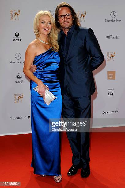 Frauke Ludowig and Kai Roeffen attend the Red Carpet for the Bambi Award 2011 ceremony at the RheinMainHallen on November 10 2011 in Wiesbaden Germany