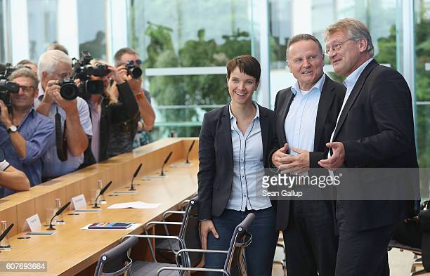 Frauke Petry and Joerg Meuthen coheads of the Alternative fuer Deutschland political party arrive with AfD Berlin candidate Georg Pazderski to speak...