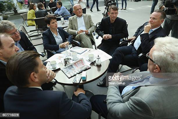 Frauke Petry and Joerg Meuthen coheads of the Alternative fuer Deutschland political party sit with other leading AfD members including AfD Berlin...