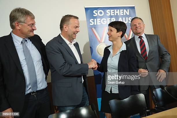 Frauke Petry cohead of the Alternative fuer Deutschland political party greets lead AfD candidate in MecklenburgWestern Pomerania LeifErik Holm as...