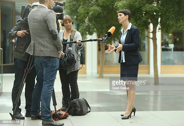 Frauke Petry cohead of the Alternative fuer Deutschland political party speaks to a television crew following an AfD press conference on September 5...