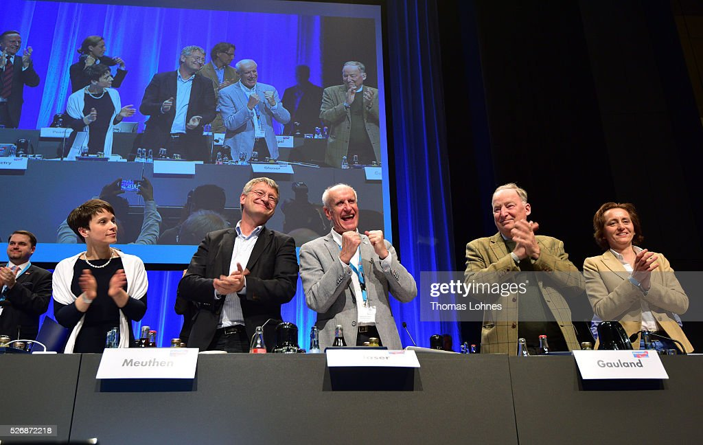 Frauke Petry (L), head of the Alternative fuer Deutschland (AfD) political party, and the party board (L-R) Joerg Meuthen, Albrecht Glaser, Alexander Gauland and Beatrix von Storch celebrate at the end of the party's federal congress on May 01, 2016 in Stuttgart, Germany. A server of the party had been hacked by a left political group and the addresses of AfD members has been published. The AfD, a relative newcomer to the German political landscape, has emerged from Euro-sceptic conservatism towards a more right-wing leaning appeal based in large part on opposition to Germany's generous refugees and migrants policy. Since winning seats in March elections in three German state parliaments the party has sharpened its tone, calling for a ban on minarets and claiming that Islam does not belong in Germany.