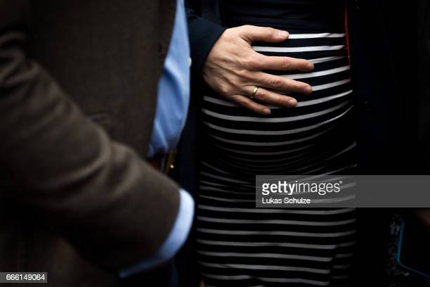 Frauke Petry head of the Alternative fuer Deutschland rightwing populist political party touches his pregnant belly during the AfD election campaign...