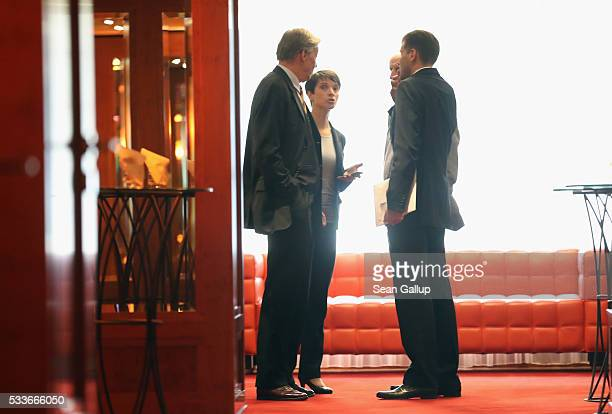 Frauke Petry head of the rightwing populist Alternative fuer Deutschland political party speaks with colleagues including AfD politician ArminPaul...