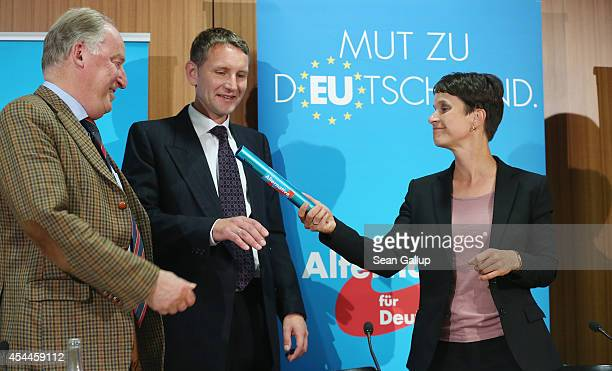 Frauke Petry lead candidate for the AfD political party in recent Saxony state elections hands over a symbolic relay baton to Bjoern Hoecke AfD lead...