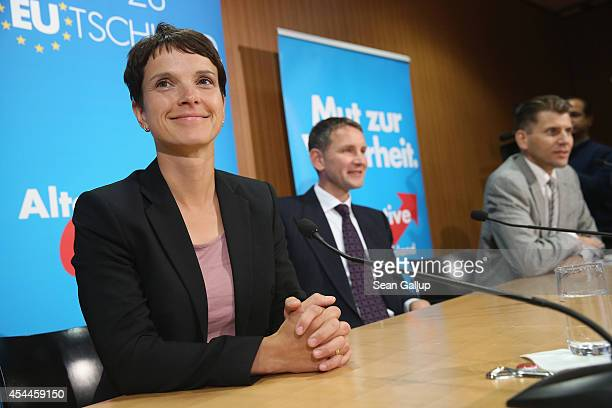 Frauke Petry lead candidate for the AfD political party in recent Saxony state elections speaks to the media with Bjoern Hoecke AfD lead candidate in...