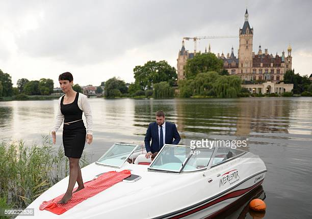 Frauke Petry leader of the antimigrant populists AfD arrives in a boat for an election results party in front of the regional parliament on September...