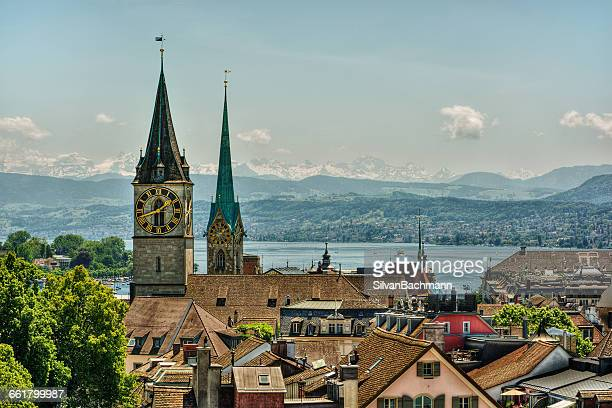 Fraumunster and St Peter church towers and clock face and city skyline, Zurich, Switzerland