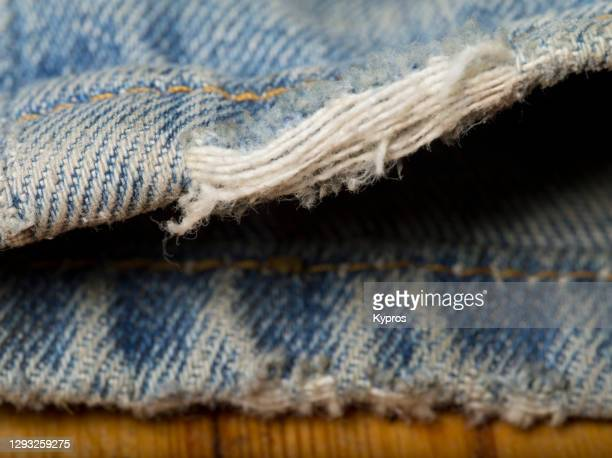 frayed denim jeans - womenswear stock pictures, royalty-free photos & images