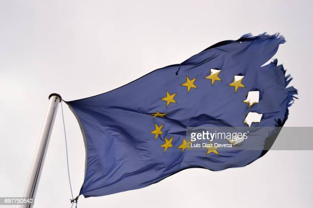 frayed european flag - brexit stock pictures, royalty-free photos & images