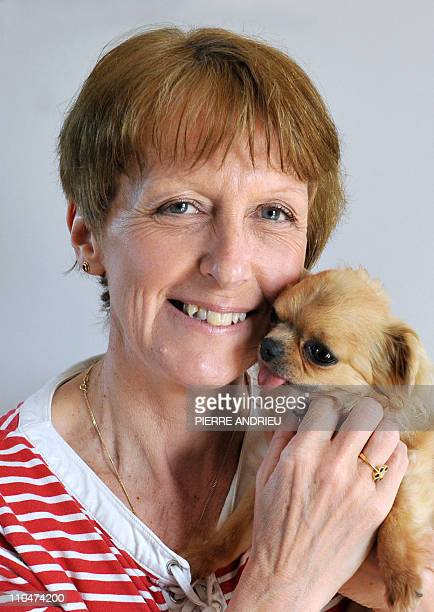 FRAYSSEBritish MariaLouise Sawyer poses with her dog on March 16 2011 at her home in the French western village of Chazelles Left alone in France...