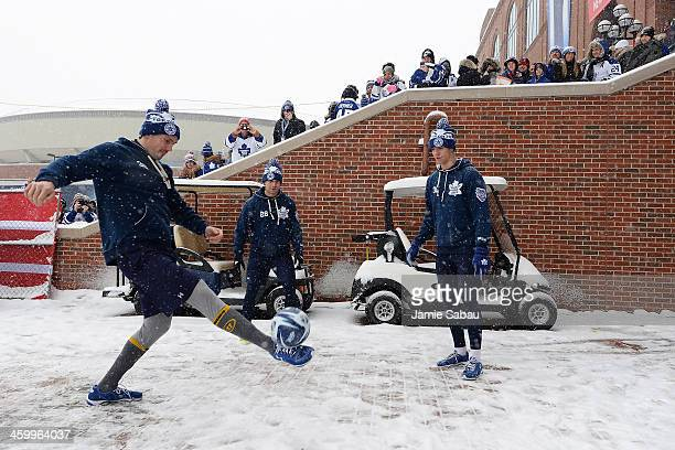 Frazer McLaren JohnMichael Liles and Carl Gunnarsson of the Toronto Maple Leafs kick a soccer ball prior to playing the Detroit Red Wings in the 2014...