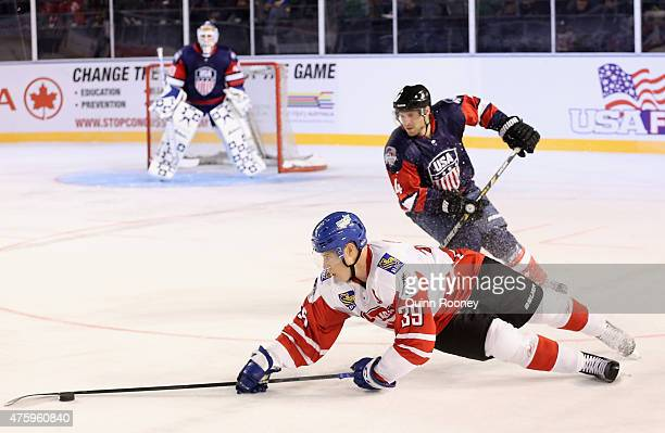 Frazer McLaren of Canada dives for the puck during the 2015 Ice Hockey Classic match between the United States of America and Canada at Rod Laver...