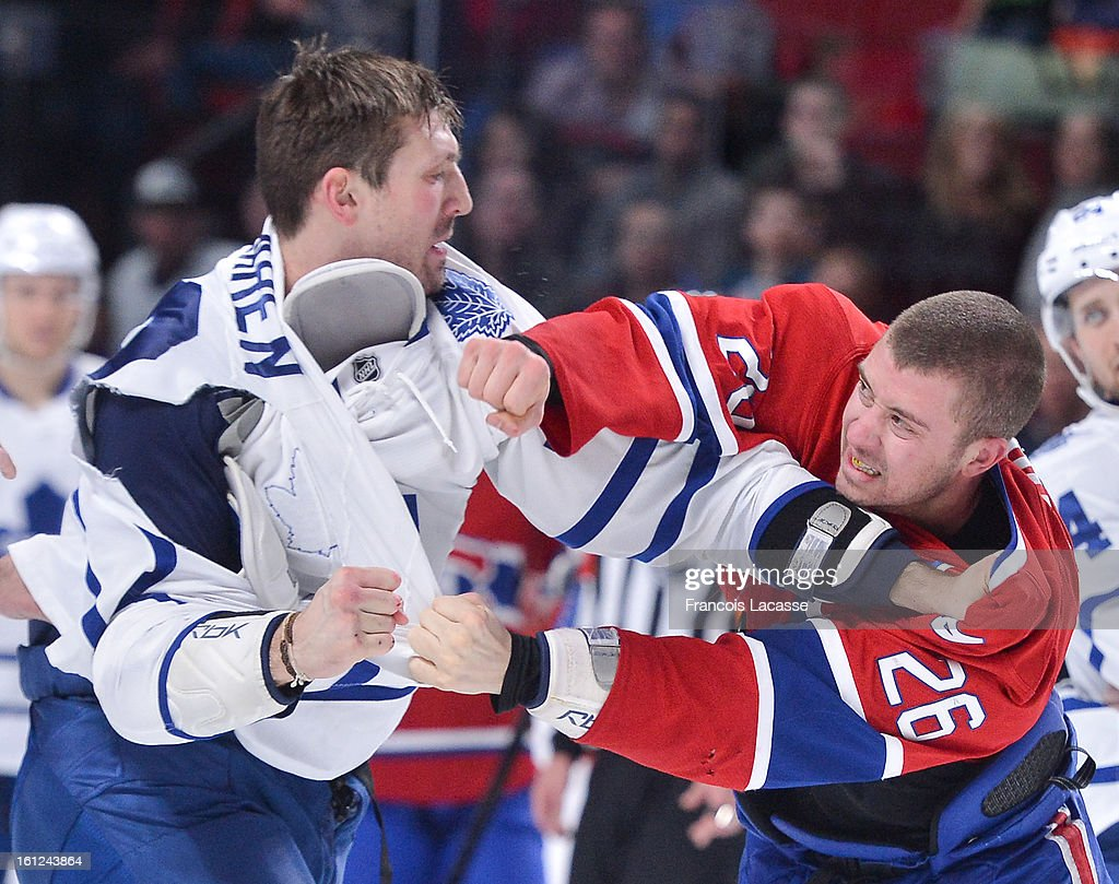 Frazer McLaren #38 of the Toronto Maple Leafs and Josh Georges #26 of the Montreal Canadiens exchange punches during the NHL game on February 9, 2013 at the Bell Centre in Montreal, Quebec, Canada.