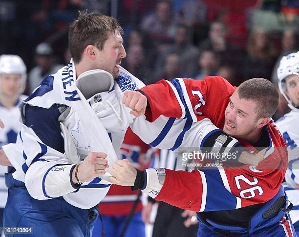 Frazer McLaren of the Toronto Maple Leafs and Josh Georges of the Montreal Canadiens exchange punches during the NHL game on February 9 2013 at the...