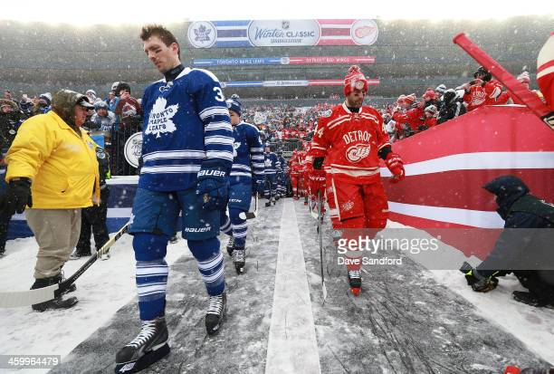 Frazer McLaren of the Toronto Maple Leafs and Todd Bertuzzi of the Detroit Red Wings make their way to the ice surface for warmup prior to the 2014...
