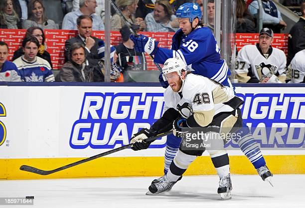 Frazer McLaren of the Toronto Maple Leafs battles for the puck with Joe Vitale of the Pittsburgh Penguins during NHL game action October 26 2013 at...