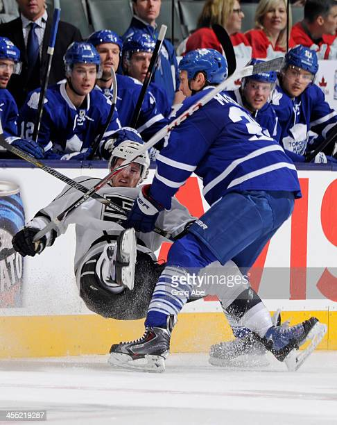 Frazer McLaren of the Toronto Maple Leafs checks Colin Fraser of the Los Angeles Kings during NHL game action December 11 2013 at the Air Canada...