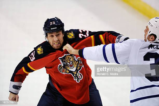 Frazer McLaren of the Toronto Maple Leafs fights withTyson Strachan of the Florida Panthers during a NHL game at the BBT Center on February 18 2013...