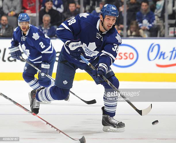 Frazer McLaren of the Toronto Maple Leafs fires a puck into the zone against the Los Angeles Kings during an NHL game at the Air Canada Centre on...