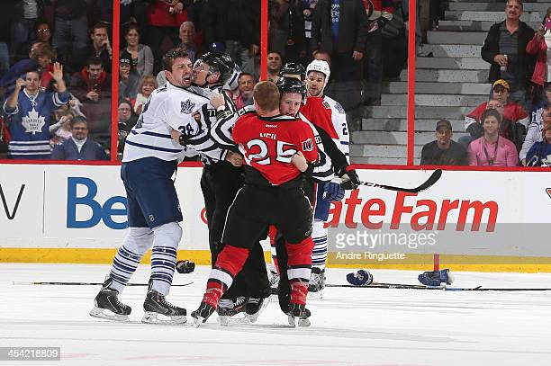 Frazer McLaren of the Toronto Maple Leafs has words with Chris Neil of the Ottawa Senators after their fight at Canadian Tire Centre on December 7...