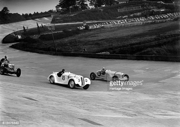 Frazer-Nash BMW and Alvis cars racing at Brooklands. Left MG K3 1087S cc. Event Entry No: 14. Centre Frazer-Nash BMW 1971 cc. Event Entry No: 10....