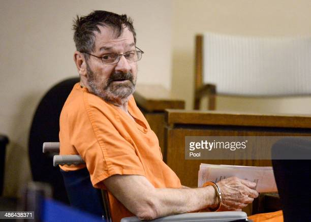Frazier Glenn Cross also known as Frazier Glenn Miller sits with his defense team after being wheeled into a Johnson County courtroom for a...