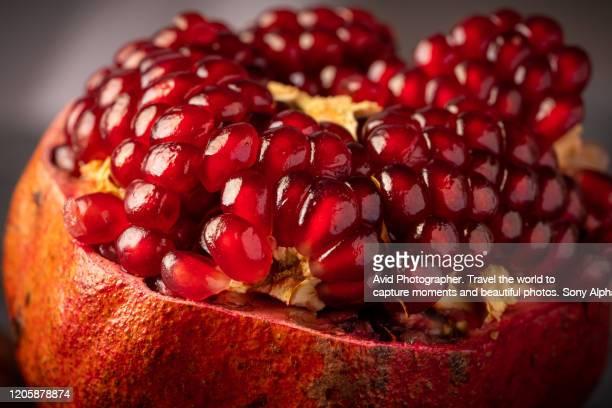 fresh delicious pomegranate dark surface
