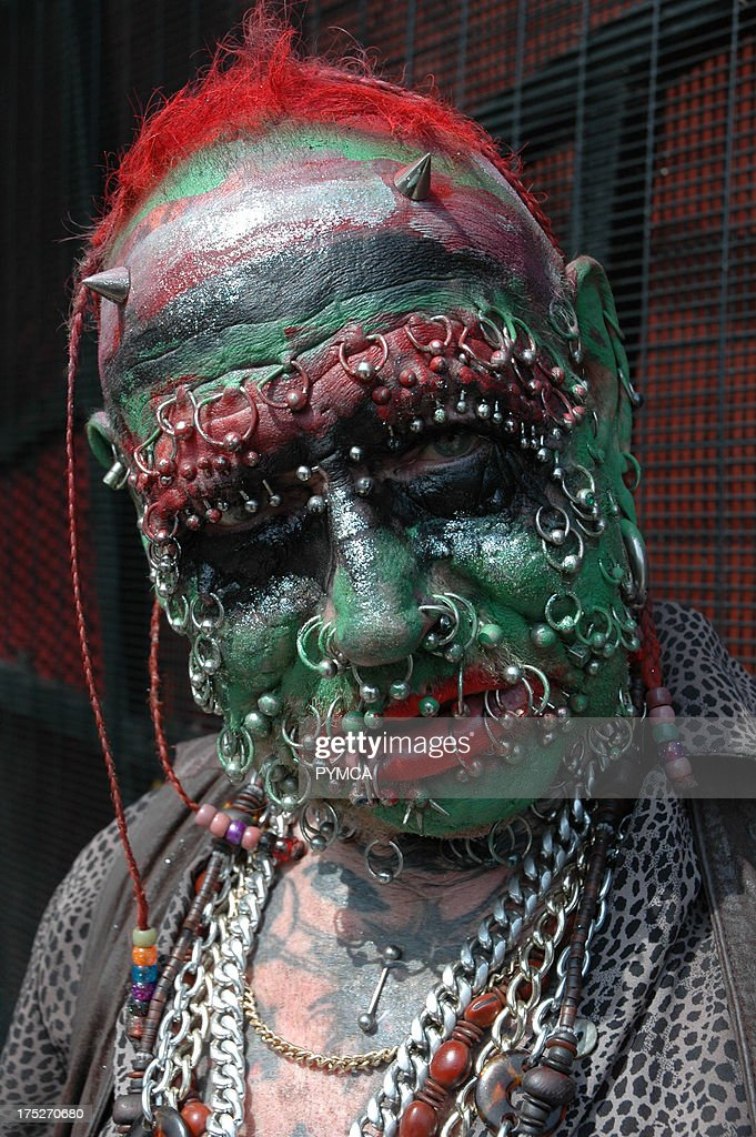 A freaky looking man with piercings all over his face, Camden, 2006 : News Photo