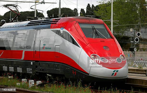 A Freccia Rossa highspeed train operated by Trenitalia SpA arrives at Tiburtina station in Rome Italy on Friday April 20 2012 Nuovo Trasport...