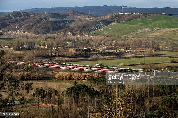 A Freccia Rossa highspeed train operated by Trenitalia SpA travels in Orvieto Italy on Saturday Feb 6 2016 The Poste Italiane IPO which valued the...