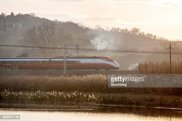 A Freccia Rossa highspeed train operated by Trenitalia SpA travels outside Rome Italy on Saturday Feb 6 2016 The Poste Italiane IPO which valued the...